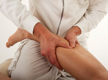 legs of a man massaged by the massager