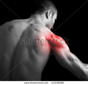 stock-photo-young-muscular-man-with-shoulder-pain-on-black-background-112236686